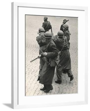 Cops Hit a Demonstrator with Batons-Luigi Leoni-Framed Photographic Print