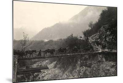 Italian Soldiers Traverse a Bridge over the Isonzo River, on the Outskirts of Caporetto-Ugo Ojetti-Mounted Photographic Print