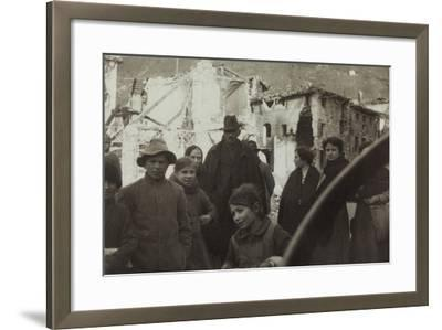 Residents of San Dona Di Piave. in the Background Buildings Destroyed by Bombing in World War I--Framed Photographic Print