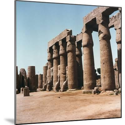 The Courtyard of Ramses Ii with Typical Papyrus Columns Inside the Temple of Luxor, in Upper Egypt-Pietro Ronchetti-Mounted Photographic Print