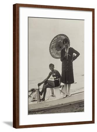 Young Woman with Umbrella and Boy on Pedal Boats on the Beach of Forte Dei Marmi--Framed Photographic Print