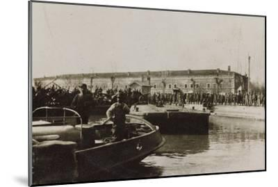 War Campaign 1917-1920: Group of Soldiers Await the Arrival of a Vessel in the Harbor--Mounted Photographic Print