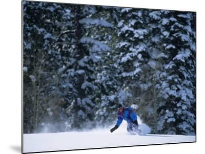 Male Snowboarder in Action--Mounted Photographic Print