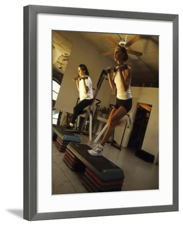 Women Performing Step Exercise with Handweights in Gym--Framed Photographic Print