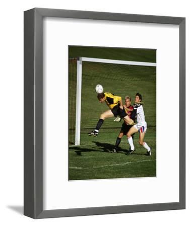 Soccer Players in Action--Framed Photographic Print