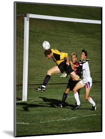 Soccer Players in Action--Mounted Photographic Print