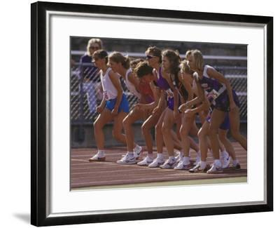 Female Runners at the Start of a Track Race--Framed Photographic Print