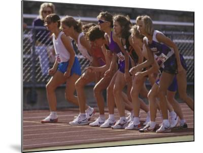 Female Runners at the Start of a Track Race--Mounted Photographic Print