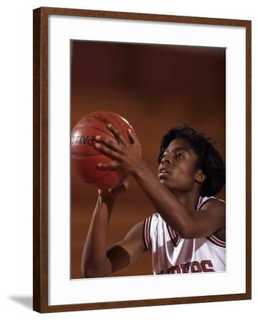 Female High Schooll Basketball Player in Action Shooting a Free Throw During a Game--Framed Photographic Print