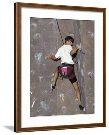 Man Wall Climbing Indoors with Equipment--Framed Photographic Print