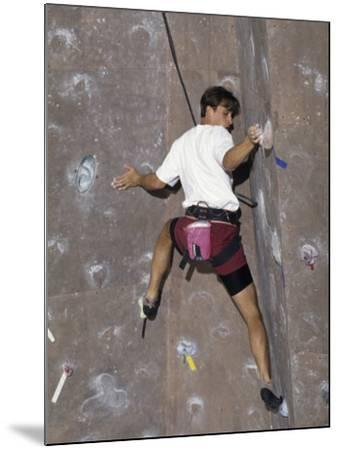 Man Wall Climbing Indoors with Equipment--Mounted Photographic Print