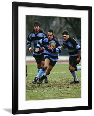 Rugby Players in Action, Paris, France-Paul Sutton-Framed Photographic Print