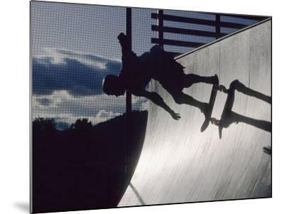 Skateboarder in Action on the Vert--Mounted Photographic Print