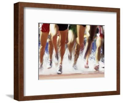 Runners Legs Splashing Through Water Jump of Track and Field Steeplechase Race, Sydney, Australia-Paul Sutton-Framed Photographic Print
