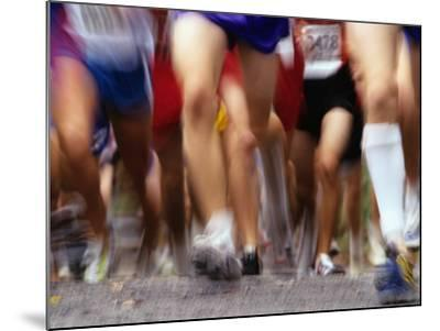 Blurred Action of Runner's Legs Competing in a Race--Mounted Photographic Print