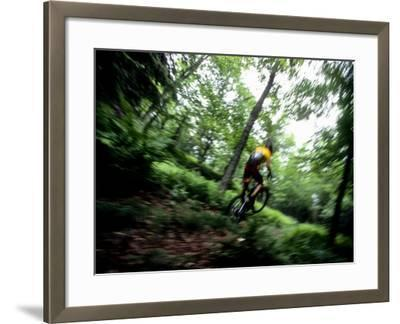 Blurred Action of Recreational Mountain Biker Riding on the Trails--Framed Photographic Print