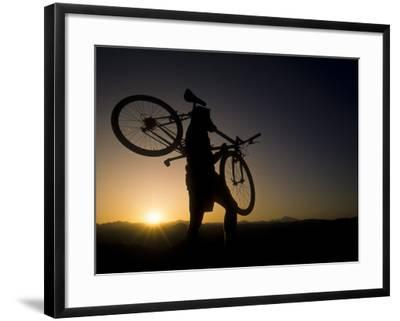 Silhouette of Mountain Biker at the Summit During Sunrise--Framed Photographic Print