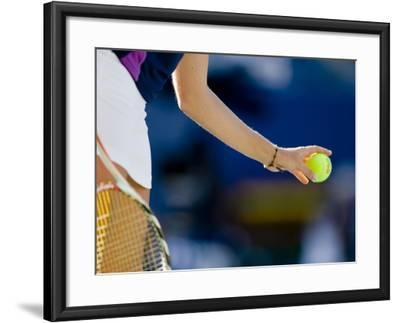 Detail of Woman Serving During Tennis Match--Framed Photographic Print