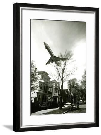 Airliner Above Residential Area--Framed Photographic Print