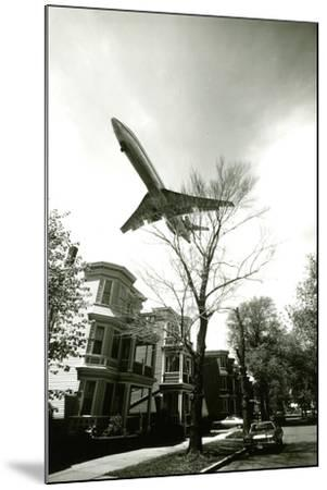Airliner Above Residential Area--Mounted Photographic Print