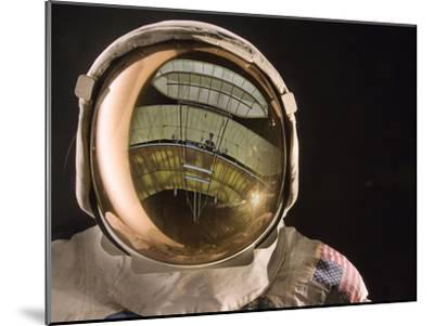 Air and Space: Apollo Helmet Visor reflecting the 1903 Wright Flyer--Mounted Photographic Print