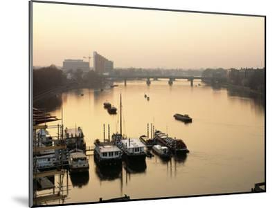 Houseboats Moored on River Thames with Putney Bridge at Sunset, Uk-Simon Warren-Mounted Photographic Print
