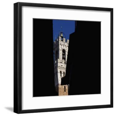 Siena Architectural Details. Glimpse of Crenellated Tower with Bell-Mike Burton-Framed Photographic Print
