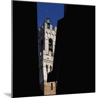 Siena Architectural Details. Glimpse of Crenellated Tower with Bell-Mike Burton-Mounted Photographic Print
