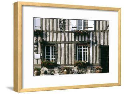 A Typical Traditional Timber Framed Building with Flowers in Window Boxes- LatitudeStock-Framed Photographic Print