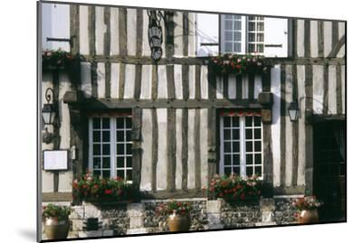 A Typical Traditional Timber Framed Building with Flowers in Window Boxes- LatitudeStock-Mounted Photographic Print