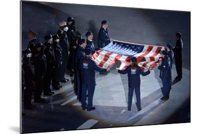 The Us Olympic Team Holds the American Flag That Flew over the Ground Zero--Mounted Photo