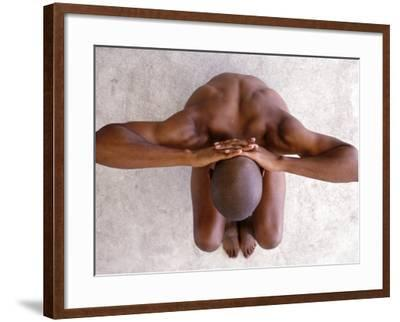 Aerial View of Nude Man Crouching--Framed Photographic Print