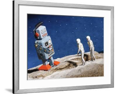 Astronaut Figurines Standing Beside Gray Toy Rocket--Framed Photographic Print