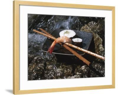 Elegant Sushi and Chopsticks Beside Rushing Water--Framed Photographic Print
