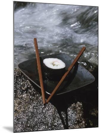 Elegant Sushi and Chopsticks Beside Rushing Water--Mounted Photographic Print