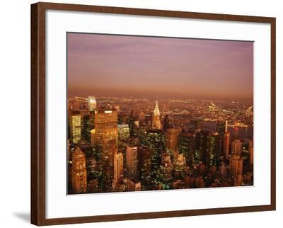 Aerial View of New York City at Night with Illuminating Lights from Buildings and Skyscrapers--Framed Photographic Print