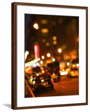 Blurred View of Cars and Illuminating Lights and Signs on Busy City Street at Night--Framed Photographic Print