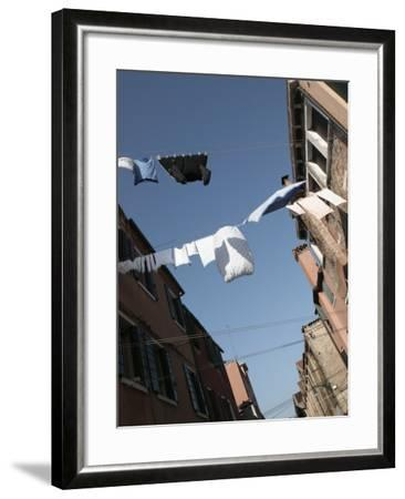 Apartment Buildings with Laundry Hanging Out to Dry on Clothes Line--Framed Photographic Print