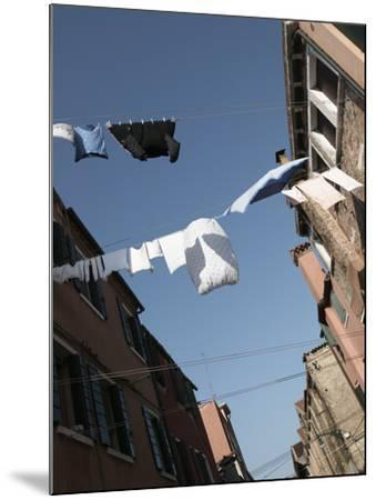 Apartment Buildings with Laundry Hanging Out to Dry on Clothes Line--Mounted Photographic Print