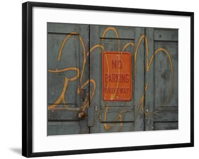 Gray Wooden Doors with Yellow Grafiti Lettering and an Orange Sign--Framed Photographic Print