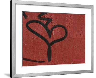Close-up of a Red Wall and a Black Grafiti Heart Shape--Framed Photographic Print