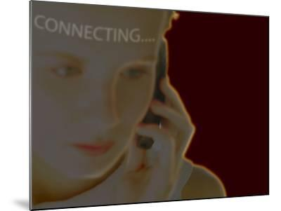 Woman Using Cell Phone with Superimposed Word Connecting--Mounted Photographic Print