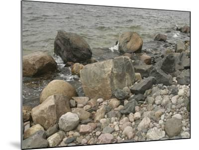 Large and Small Rocks on the Shore with Water Splashing--Mounted Photographic Print