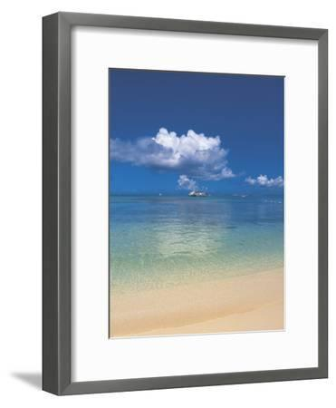 A Beach with the Blue Ocean and Sky with White Clouds--Framed Photographic Print
