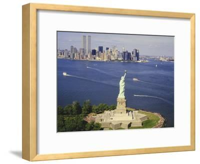 The Statue of Liberty and the New York Skyline--Framed Photographic Print
