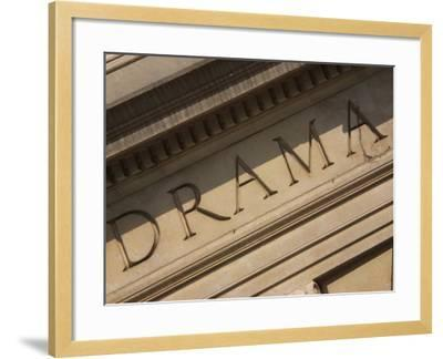 Drama Engraved on Building--Framed Photographic Print