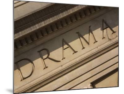 Drama Engraved on Building--Mounted Photographic Print