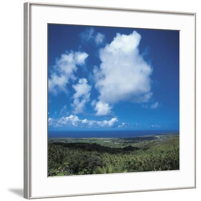 Fluffy White Clouds Over a Blue Ocean and Beach--Framed Photographic Print