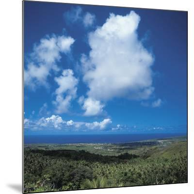 Fluffy White Clouds Over a Blue Ocean and Beach--Mounted Photographic Print