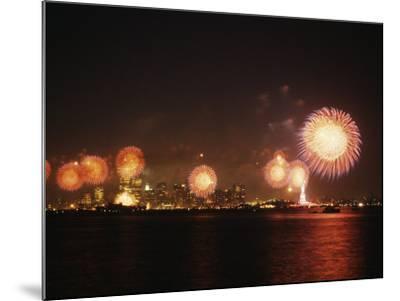 Fireworks Celebration with Manhattan Skyline and Statue of Liberty, Manhattan, New York--Mounted Photographic Print